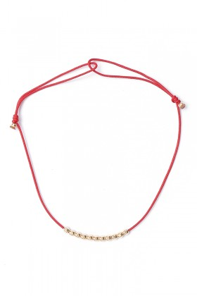 Red bracelet with golden beads