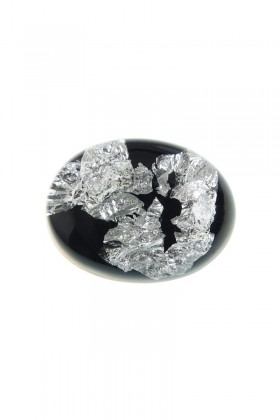 Black brooch with silver flakes