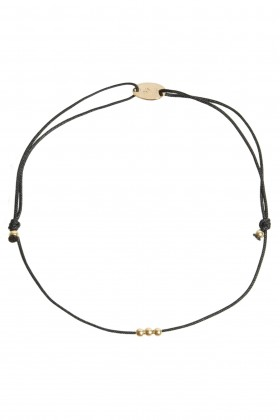 Black bracelet with golden heart