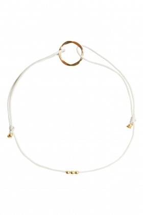 Grey bracelet with golden karma