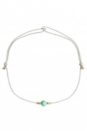 Grey bracelet with Magnesite and golden beads