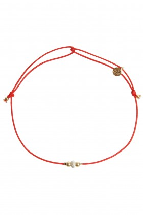 Red bracelet with silver color bead and golden beads