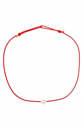 Red bracelet with silver heart